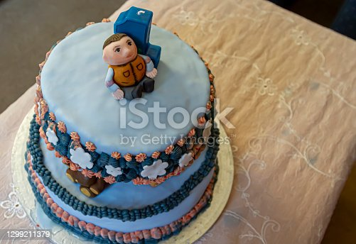 istock Special made first birthday cake for a boy featuring zoo animals in between two tiers of a cake 1299211379