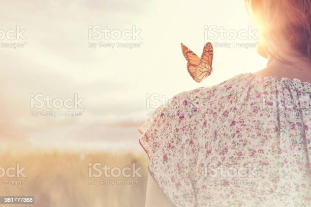 Special moment of meeting between a butterfly and a girl in the of picture id981777368?b=1&k=6&m=981777368&s=612x612&h=ud8yukp04xj2afz4xq2 2mqmt1wj4il7pax yi9drsg=