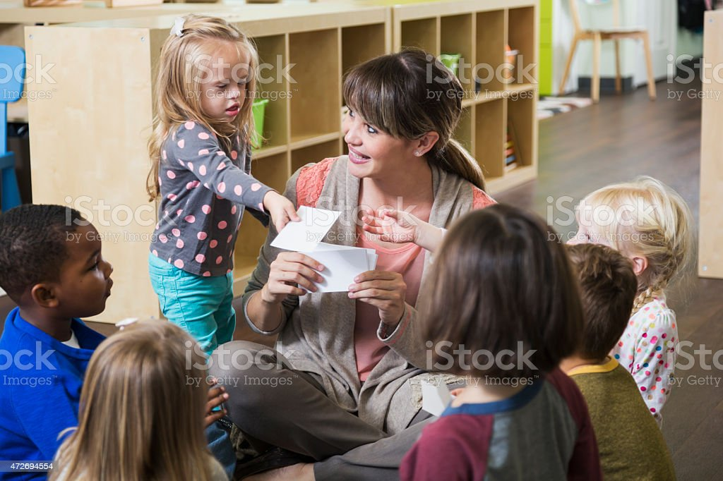 Special needs child in preschool class with group stock photo