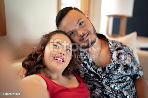 Special needs couple taking a selfie