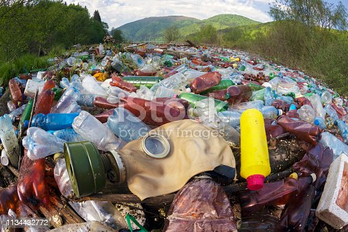Pollution of household waste of clean mountain rivers in the Carpathians Ukraine is a huge problem for people. Special workers collect garbage, as a symbol of saving the planet Earth