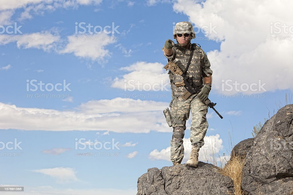 Special ops military soldier pointing royalty-free stock photo