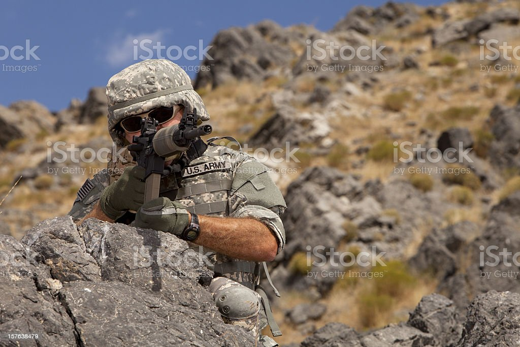 Special ops military soldier shooting an assault rifle stock photo
