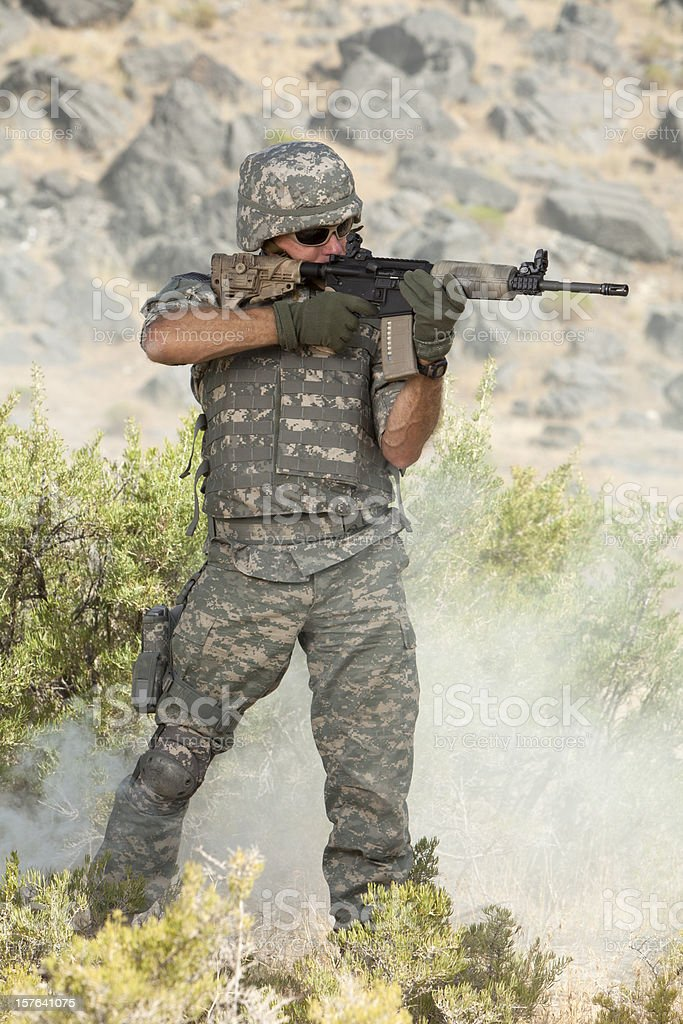 Special ops military soldier shooting an assault rifle royalty-free stock photo