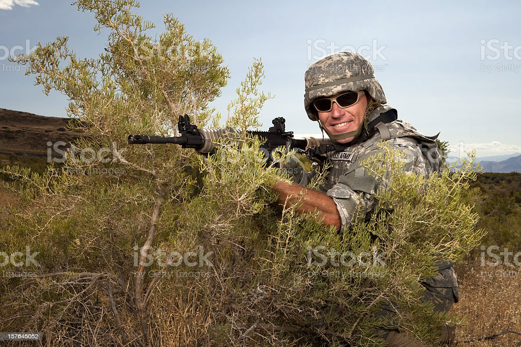 Special ops military soldier smiling in tactical position stock photo