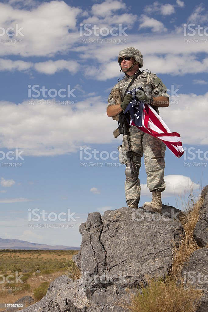 Special Ops Soldier holding an American Flag stock photo