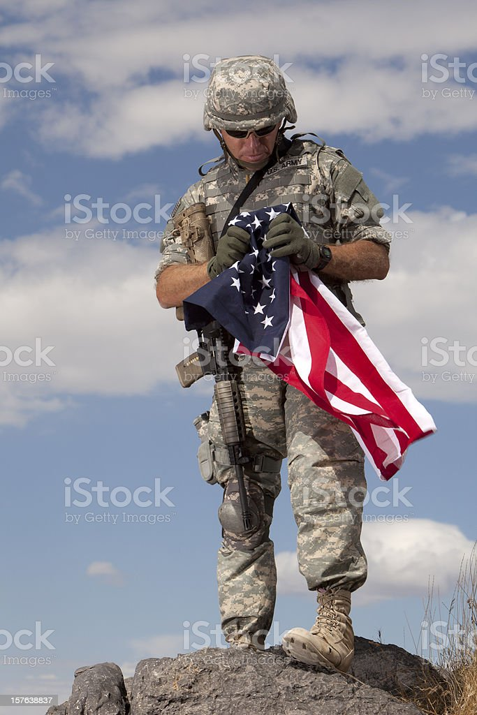Special Ops Soldier Looking at an American Flag stock photo