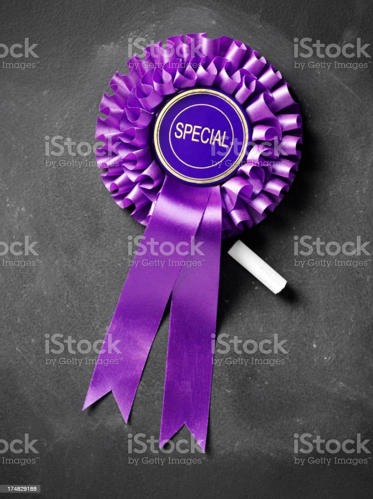 Special Purple Rosette on a Blackboard royalty-free stock photo