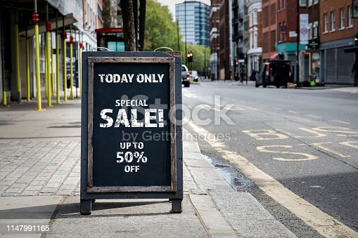 Special Sale Discount. Foldable advertising poster on the street