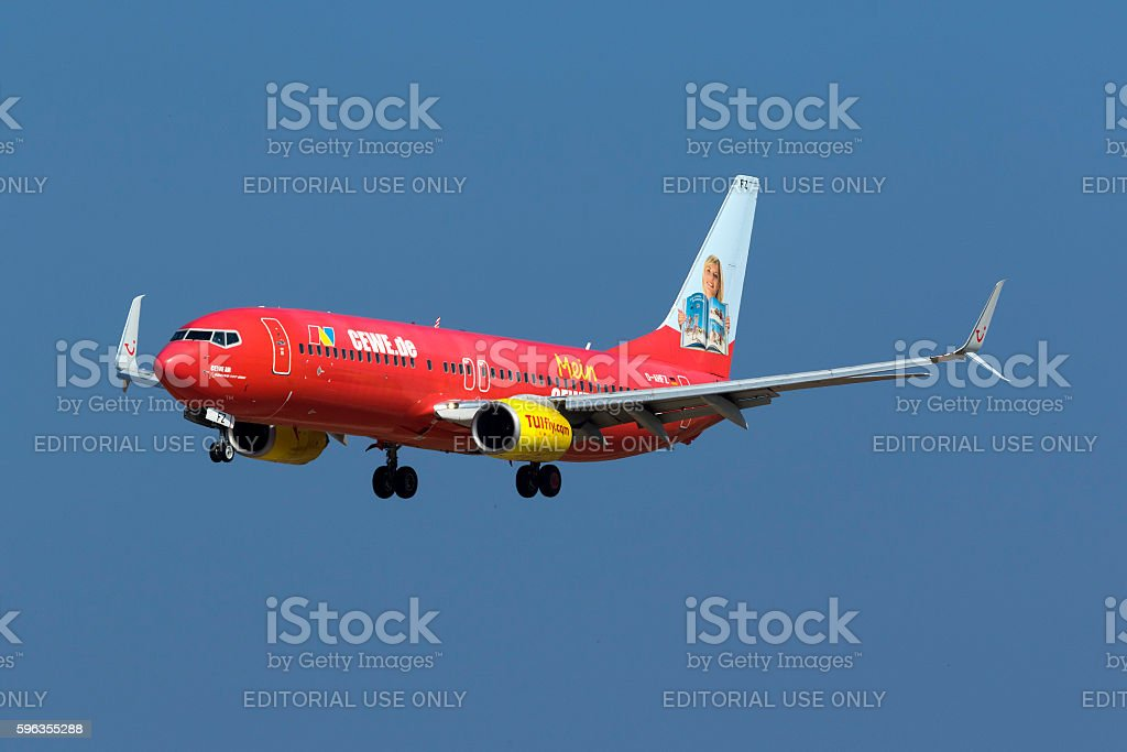 Special Scheme TUIfly jetliner landing royalty-free stock photo