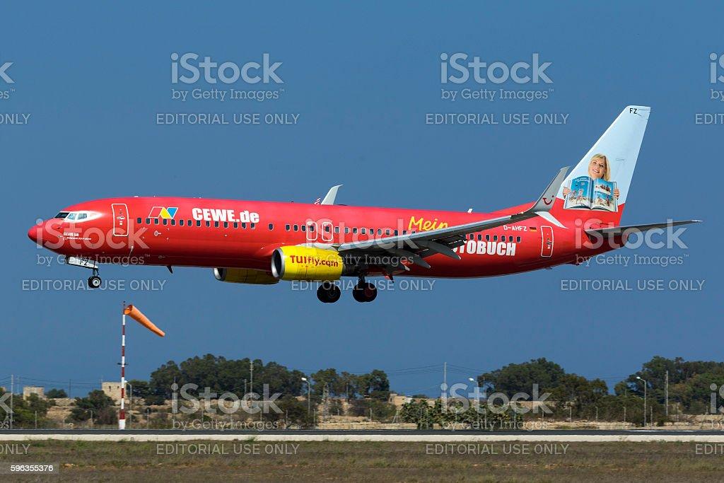 Special Scheme TUIfly jetliner landing royalty-free stock photo
