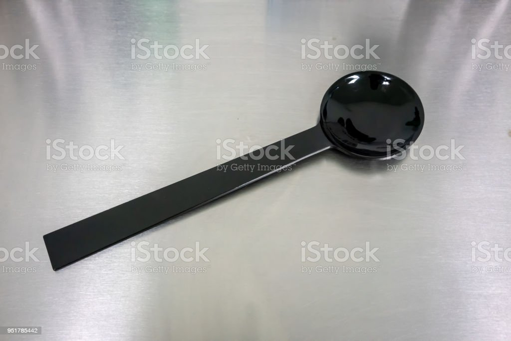 Special tool made of black plastic for eye blocking during eye vision checking or eye exam. stock photo