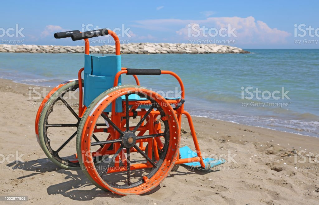 special wheelchair on the beach stock photo