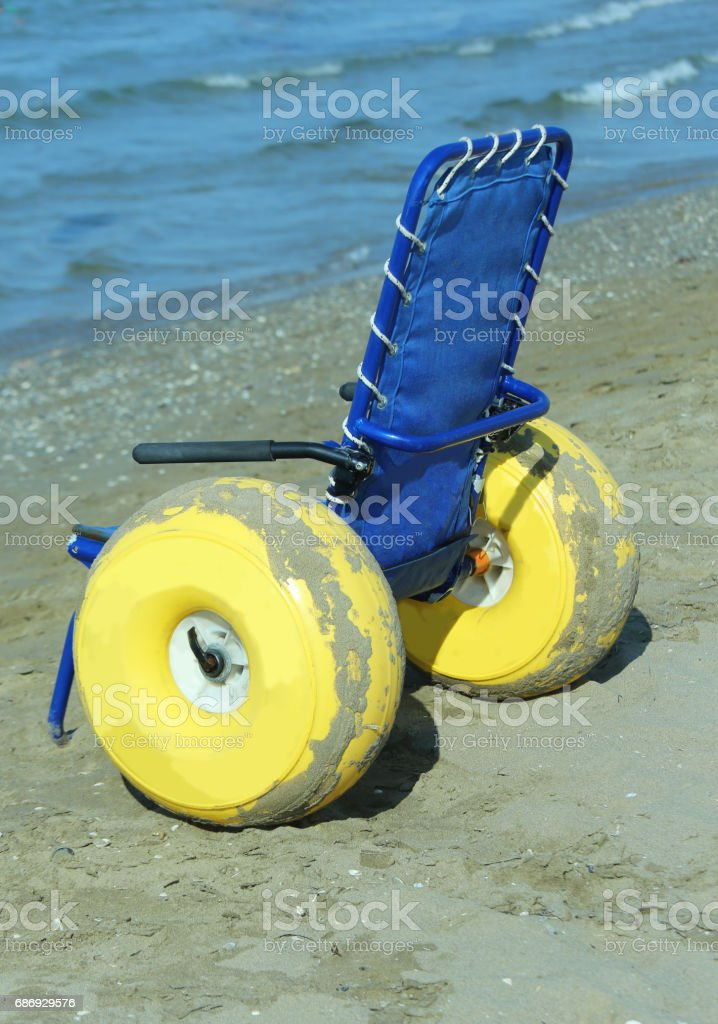 Stupendous Special Wheelchair With Large Yellow Inflatable Wheels To Interior Design Ideas Tzicisoteloinfo