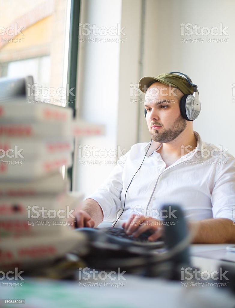 IT specialist at start up company and pizza boxes stock photo