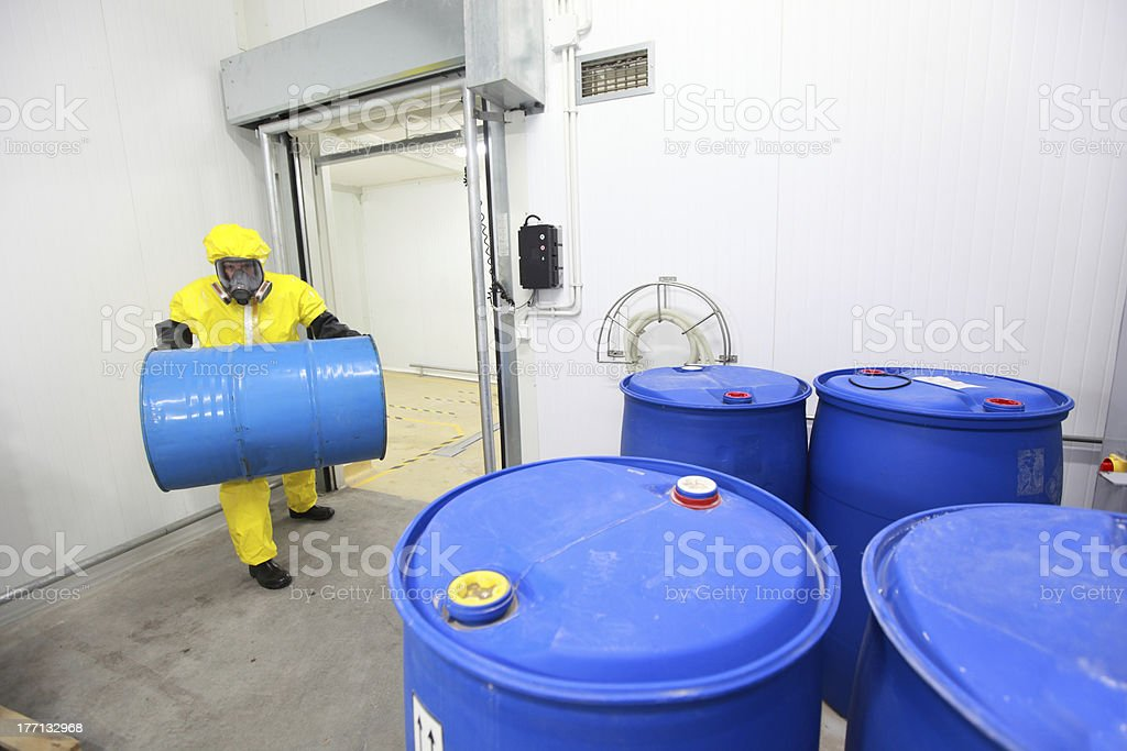 Specialist carrying barrel of chemicals royalty-free stock photo