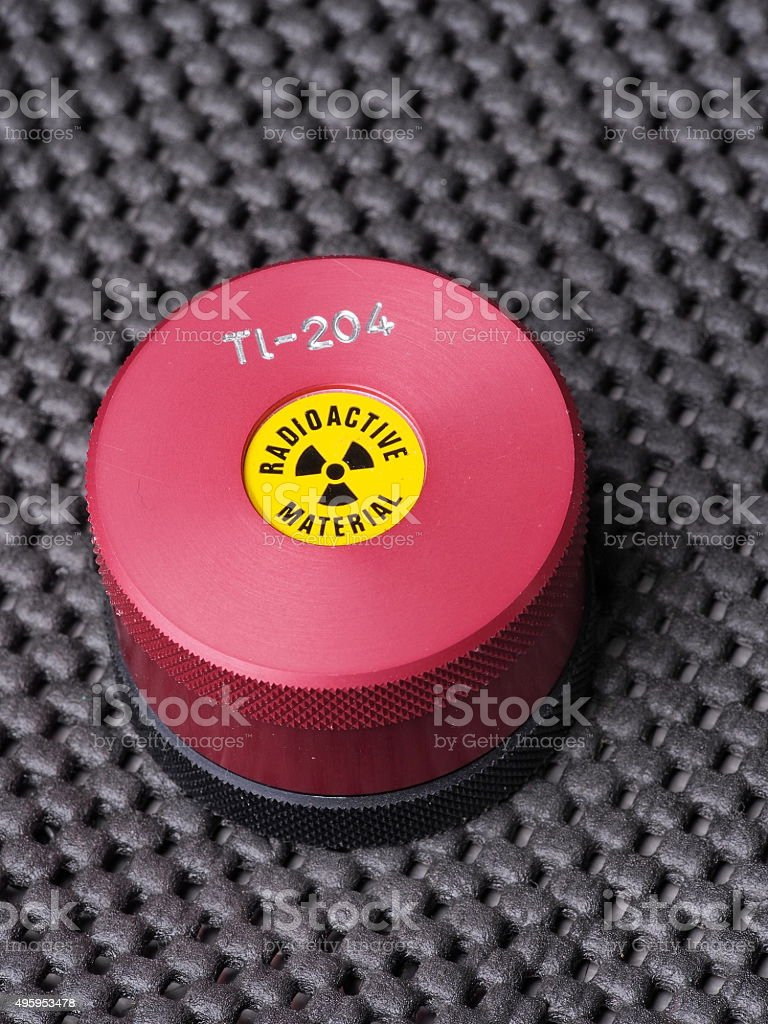 Specialist container with warning sticker  containing radioactive isotope Thallium stock photo