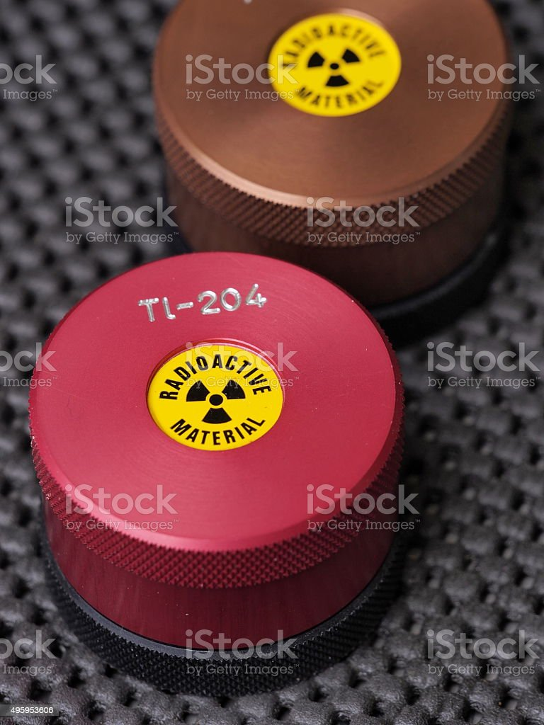 Specialist containers containing radioactive isotopes Promethium and Thallium stock photo
