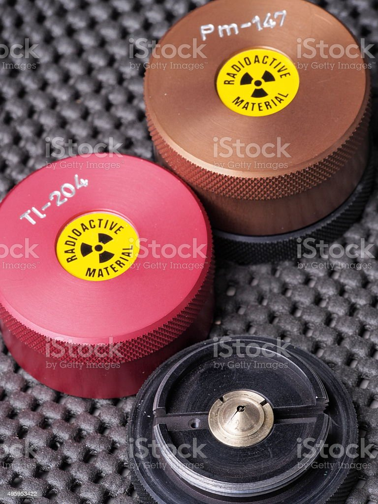Specialist containers, one opened, containing radioactive isotopes Promethium and Thallium stock photo