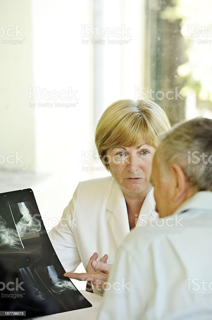 Specialist doctor explains X-rays to patient royalty-free stock photo