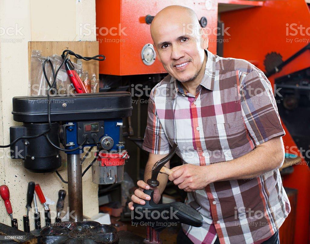Specialist fixing heel taps stock photo