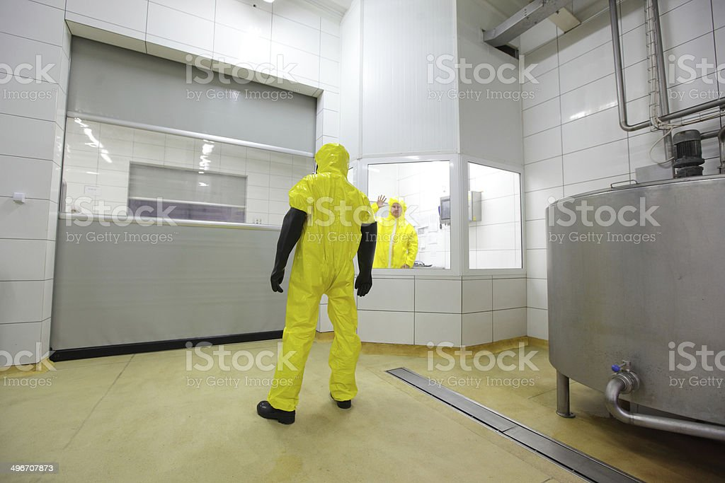 specialist in uniform in restriced access industrial area stock photo