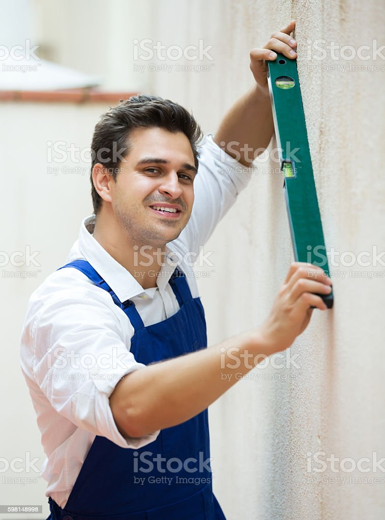 Specialist making wall plane stock photo