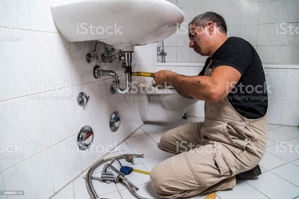 male man dirty muscle inflated worker specialist plumber in black...