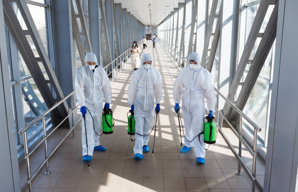 Specialists in hazmat suits making disinfection of public places Specialists in hazmat suits making disinfection of public places against new coronavirus pneumonia. decontamination stock pictures, royalty-free photos & images