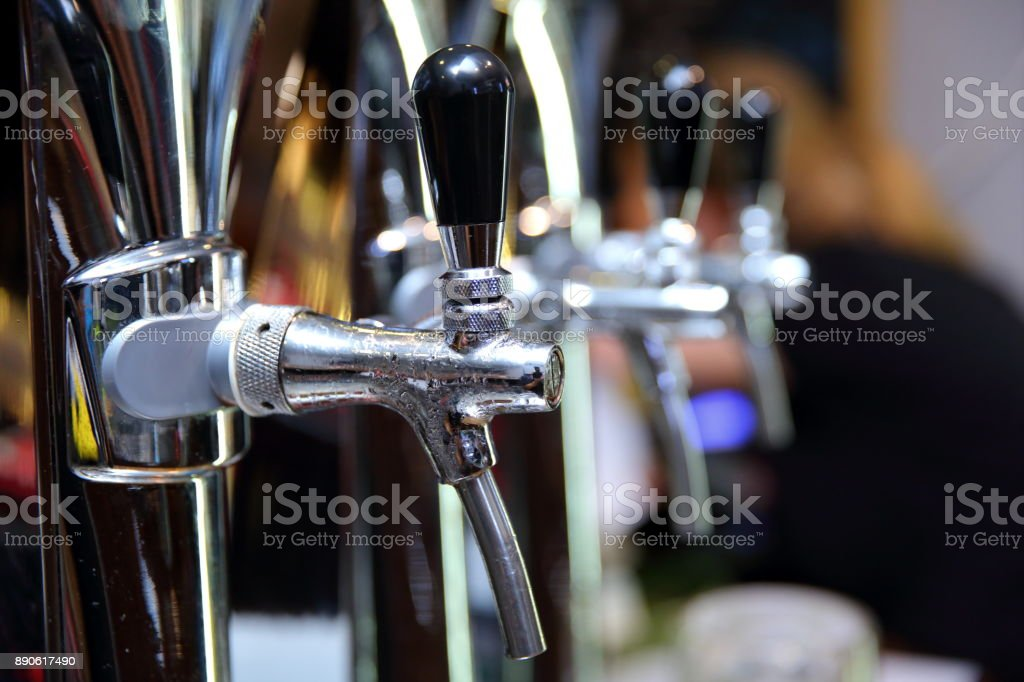 A specialized device for pouring beer from the barrel most often used in bars and pubs because it accelerates the pouring of beer to a glass of beer or a glass. stock photo