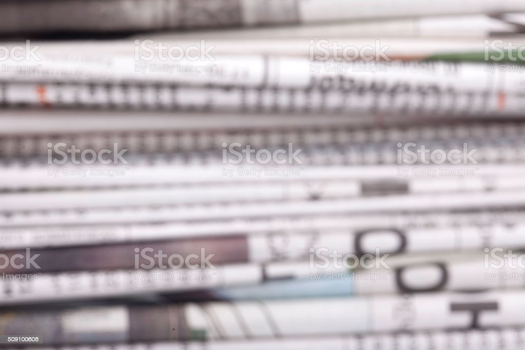 specially defocused stack of newspapers blurred background stock photo