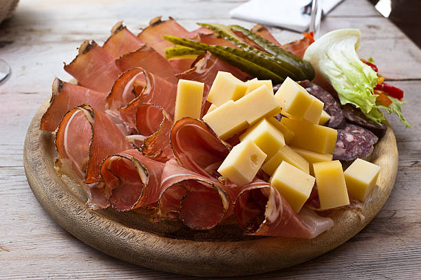 Speck and cheese cold cuts platter - South Tyrol stock photo