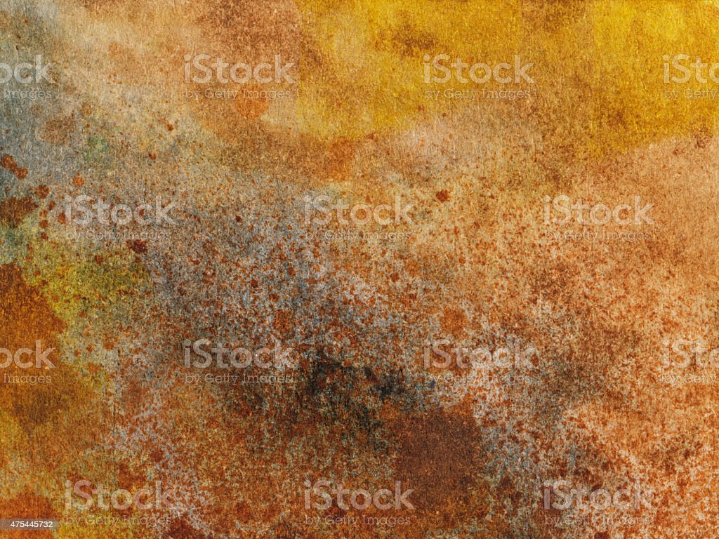 Speckled background with shades of brown and yellow stock photo