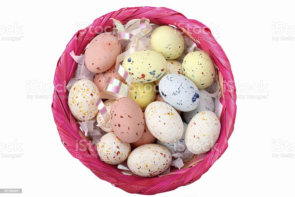 Speckled multicolored chocolate EASTER eggs in a basket royalty-free stock photo