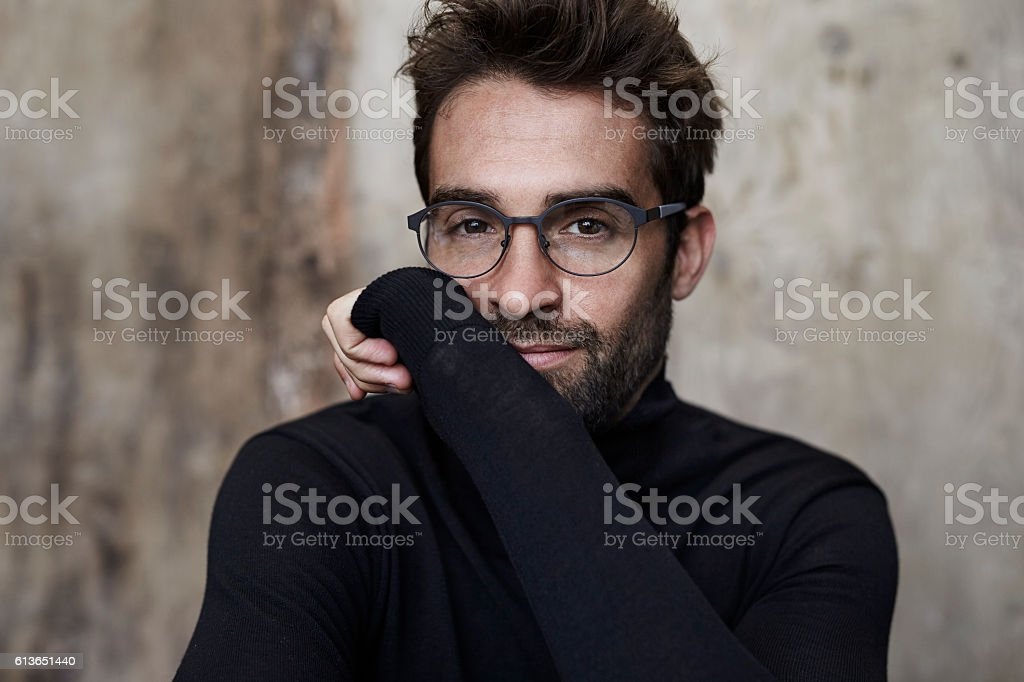 Spectacled guy in black stock photo