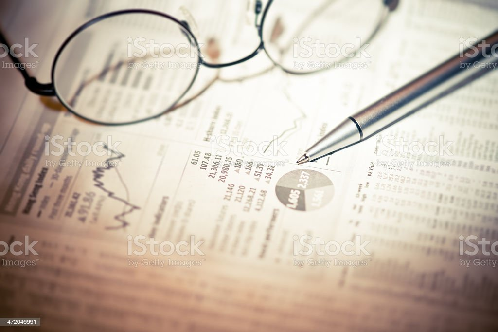 Spectacles and Pen on Documents stock photo