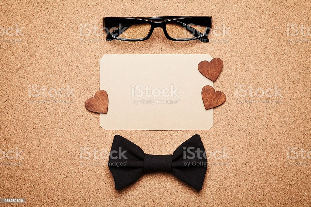 Spectacles, bowtie and empty paper blank in Happy Fathers Day stock photo