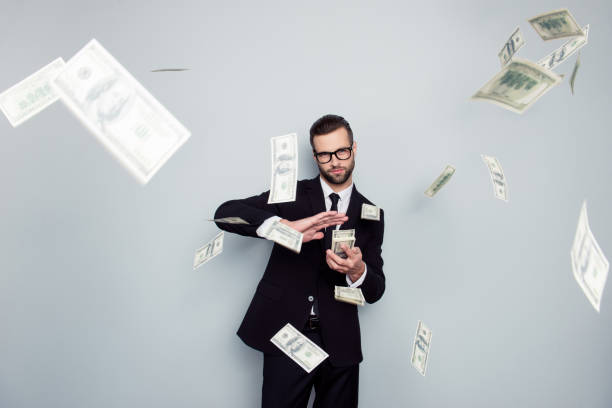 Spectacles jackpot entrepreneur economist banker chic posh manager jacket concept. Handsome confident cunning clever wealthy rich luxury guy holding wasting stack of money isolated on gray background - foto stock