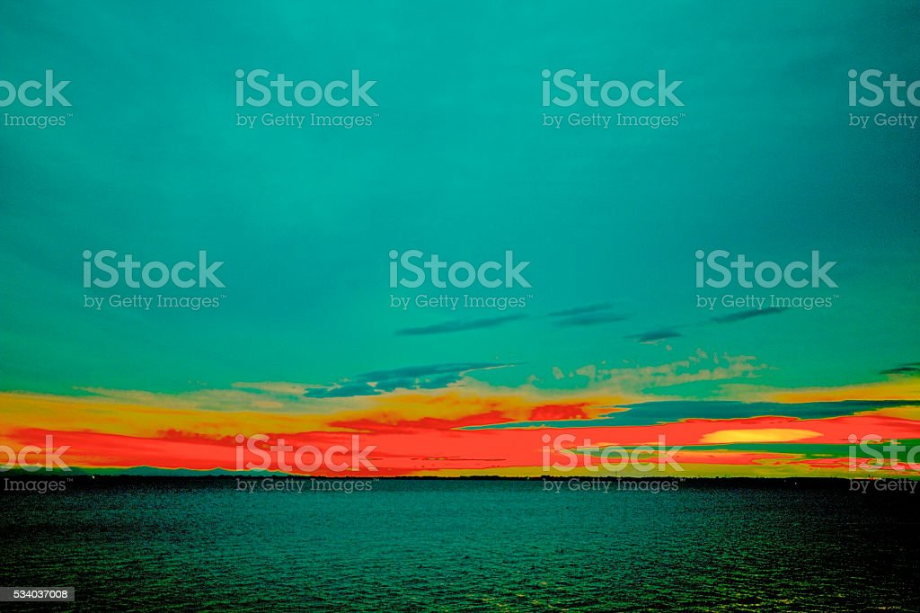 Spectacular Abstract turquoise sunset stock photo