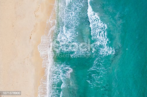 Spectacular aerial view of a beautiful white beach bathed by a clear and turquoise sea, Sardinia, Italy.