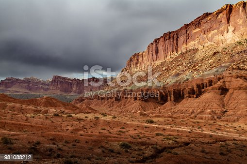 Spectacular colorful rock formations and epic storm clouds over Capitol Reef National Park in Utah, USA.