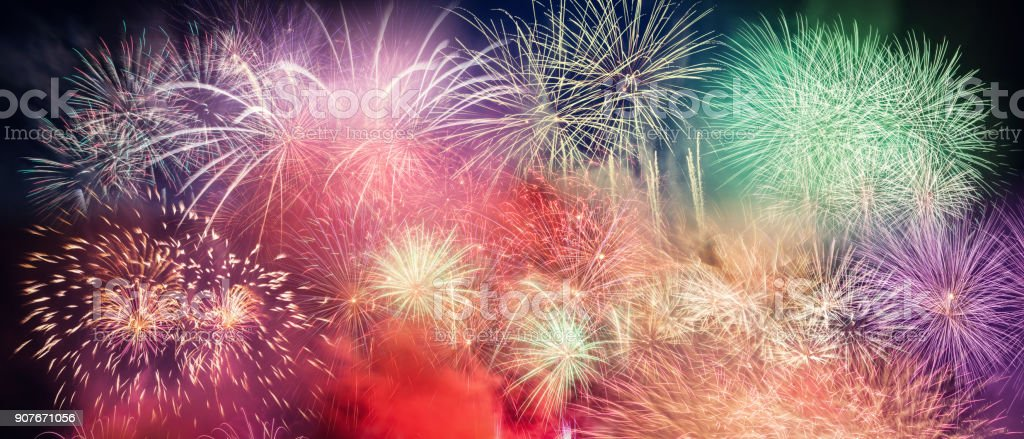 Spectacular fireworks show light up the sky. New year royalty-free stock photo