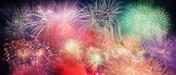 spectacular fireworks show light up the sky. new year - film festival stock photos and pictures