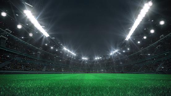 Spectacular football stadium full of spectators expecting an evening match on the grass field.