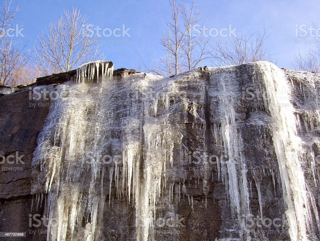 Spectacular Icy Cliff Against a Blue Sky stock photo