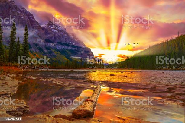 Photo of Spectacular Mountain Scene With River At Sunrise With Birds