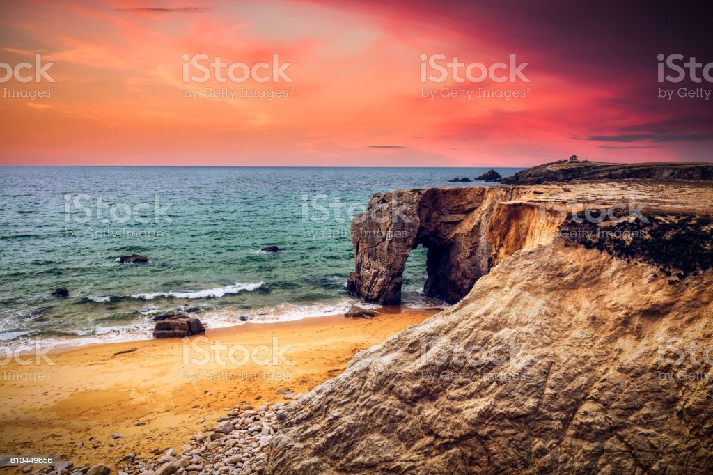 Spectacular natural cliffs and stone arch Arche de Port Blanc and beautiful famous coastline, Brittany (Bretagne), France, Europe stock photo