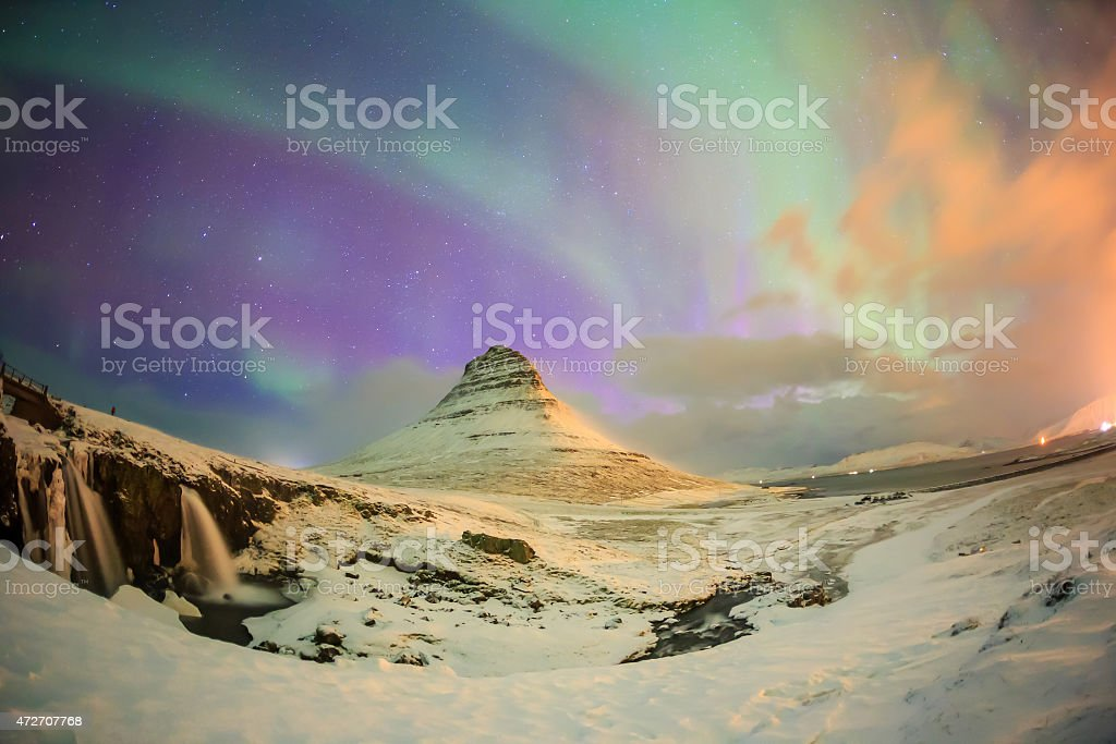 Spectacular northern lights appear over Mount Kirkjufell stock photo