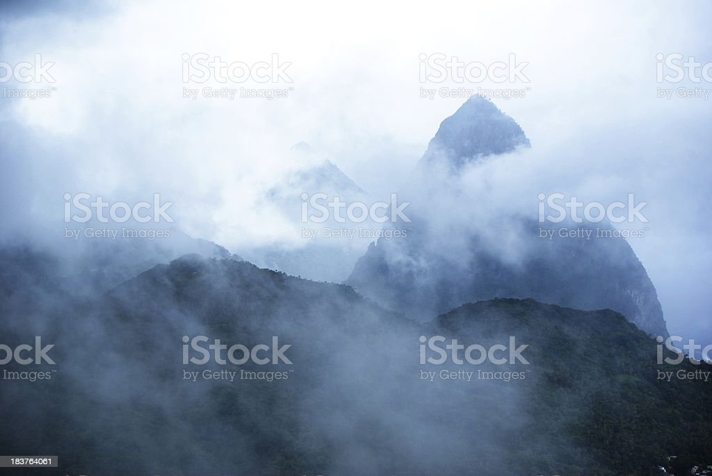 spectacular pitons mountains engulfed in fog and mist royalty-free stock photo