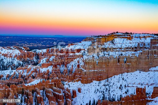 Spectacular rainbow sunset at Bryce Canyon National Park in the winter in Utah.